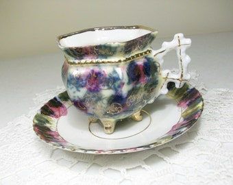 4 Footed Tea Cup & Saucer //