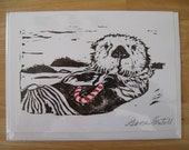 Hand printed holiday card, Candy cane sea otter