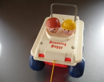 Awesome vintage Fisher Price Bouncing Buggy Pull Toy