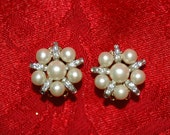 Signed Kramer vintage faux pearl and rhinestone clip on earrings