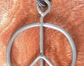 Original 1969 Woodstock Fence Necklace, from Bethel Woods museum site