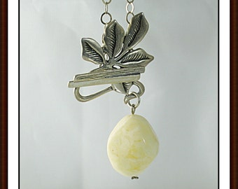 Elegant pendant of natural genuine white Baltic amber with sterling silver./100% Natural Genuine White Baltic Amber.