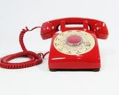 Vintage telephone cherry red rotary dial phone