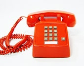 Vintage telephone tangerine orange push button phone with cord