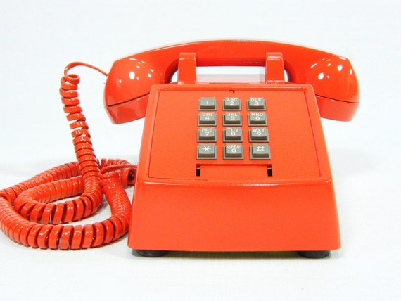 Vintage telephone tangerine orange push button phone with cord
