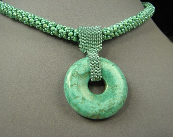 Turquoise Magnesite Donut Pendant with Light Teal Green Russian Spiral  Weave Necklace