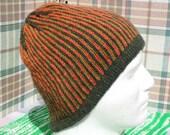 Hand knit unisex fair isle striped beanie in gold orange and green