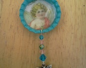 Huge sale Bottle cap necklace cherub  image with one strand of swarovski crystal beads and  charm free shipping the U.S.A