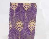 Golden peacock lined notebook.