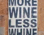 More wine less whine sign made from reclaimed plywood