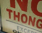 No thongs sign made from reclaimed plywood