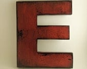 Wooden letters made from reclaimed plywood, letter E
