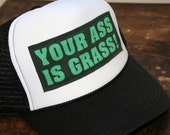 your ass is grass trucker hat