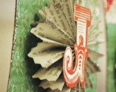 Holiday Jolly Banner with vintage book print accordion medallions and glitter