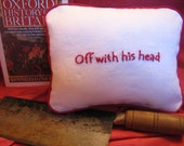 "Pillow, hand embroidered, ""Off with his head"""