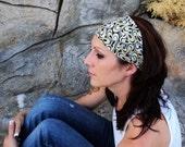 Headband black with white and yellow swirls