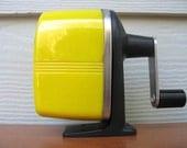 bright yellow automatic pencil sharpener