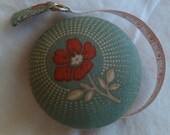 Red Flower Tape Measure - red on teal