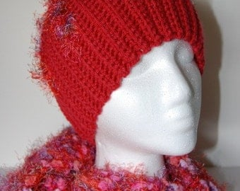 Fuzzy, nubby, funky hat/scarf in reds, purples and pink