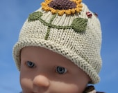 hat and booties hand knit in organic fairtrade naturally dyed cotton for 3 months baby
