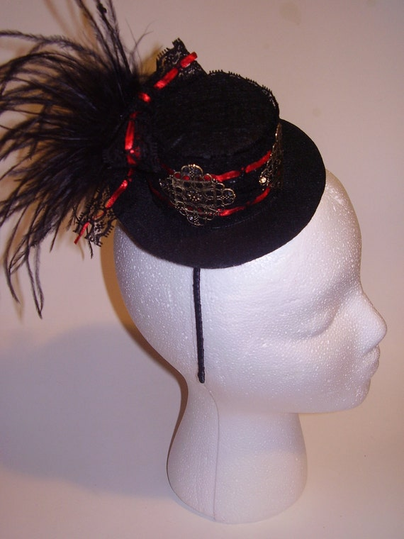 BLACK BRIDE - Mini Felt Top Hat Headpiece With Ostrich Feathers And Vintage Gold Motifs On A Black And Red Ribbon,