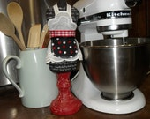 Dressmaker Form Kitchen Inspiration with Apron in Black, White and Red