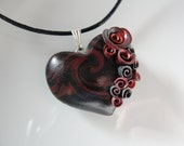 Red and black heart pendant with red roses on black cotton cord necklace