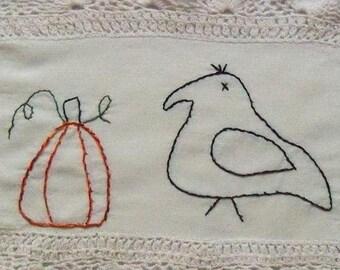 Primitive Autumn Crow Pumpkin Stitchery on vintage linen