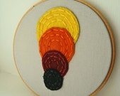 Embroidery Hoop Art with Felt Circles in Red, Yellow, Orange