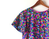 60s bright and sunny multicolored psychedelic pinwheels shirt dress short sleeves yellow pink blue teal geometry medium M