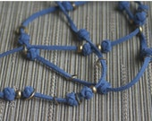 Celtic knot and brass necklace in faded blue