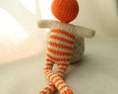 Orange striped doll -bonhomme