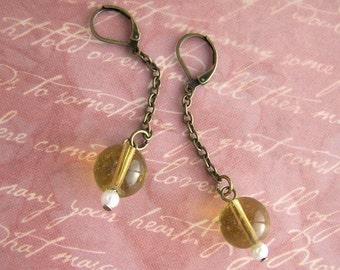 swingy amber ball earrings