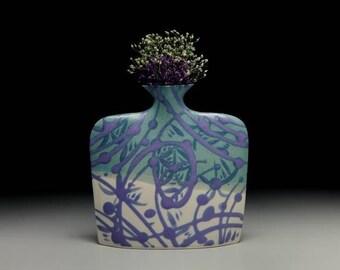 Set of 4 different colors of medium porcelain slab flower vases