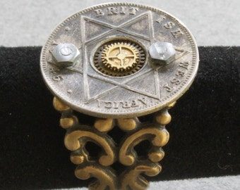 Steampunk filigree ring with old coin