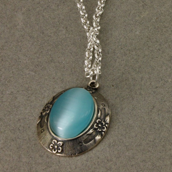 Silver Plated Oval Setting With Blue Cats Eye