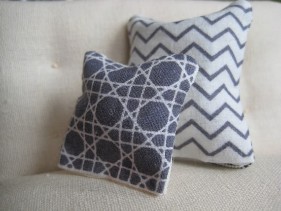 Miniature graphic black and white pillows