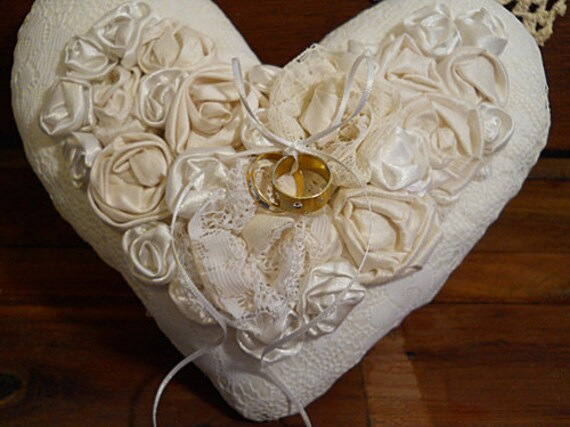 Victorian Heart Shaped Ring Bearer Wedding Pillow embellished with handmade off white and white satin roses.