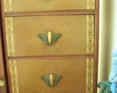 4 decorative drawer pulls, cast metal with amber celluloid
