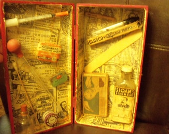 Vintage medicines and devices in shadow box, collectables