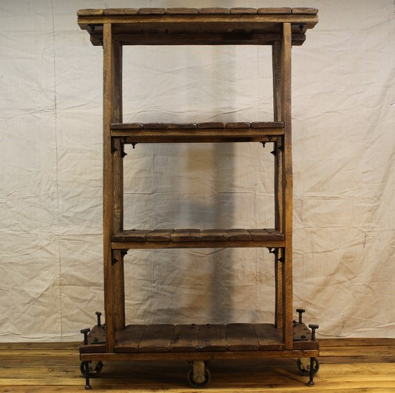 vintage industrial style shelf bookcase on casters with. Black Bedroom Furniture Sets. Home Design Ideas