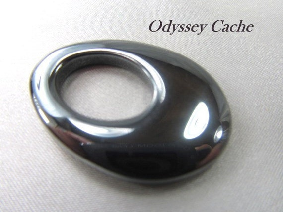 shiny black hematite semiprecious stone oval gogo by