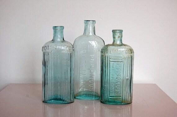 Aqua glass bottles vintage poison bottle set of three for Uses for old glass bottles