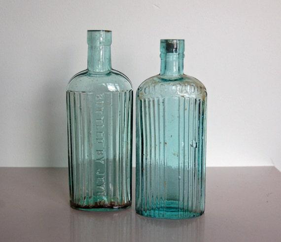 Aqua glass bottles vintage poison bottle aquatwo antique for Uses for old glass bottles