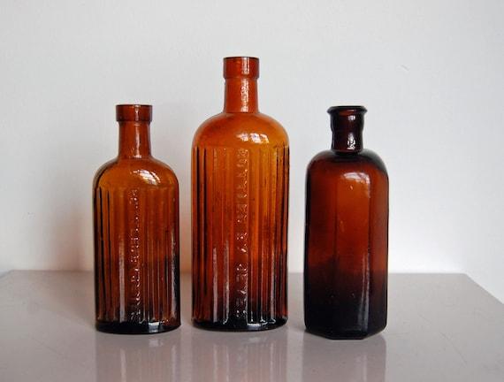 Amber glass bottles vintage reddish brown bottle set by for Uses for old glass bottles