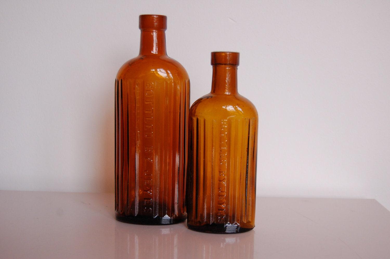 Amber glass bottles vintage brown bottle set of two for Retro glass bottles