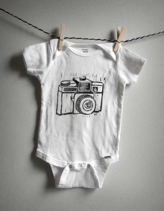hand-printed linocut Holga baby onesie