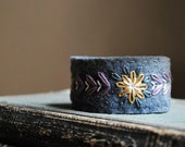 Felt Bracelet Cuff Hand Embroidered Grey Wool Felt with Purple, Ivory and Mustard Yellow Embroidery by love maude