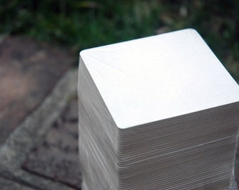 250 Blank 4 inch Square Coasters, heavyweight.  Perfect for letterpress, crafts, etc.  Made of recycled pulpboard paper