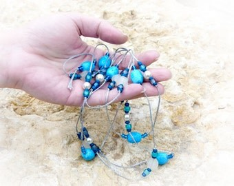 Sea Dream Hand-knotted Turquoise beaded lariat necklace. December birthstone jewelry